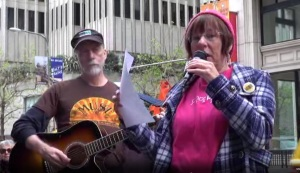 Fukushima4thAnniversary_Janet-Weil_poem_Vic-Sadot_guitar_JapaneseConsulate-SanFrancisco3-11-15-IWJ-SF-Ustream-screenshot